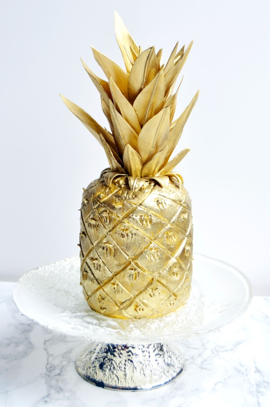 gold pineapple fondant cake